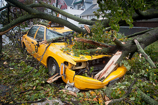 """NYC taxi cab crushed in Ditmas Park"" by Adrian Kinloch via Flickr (Creative Commons License)"